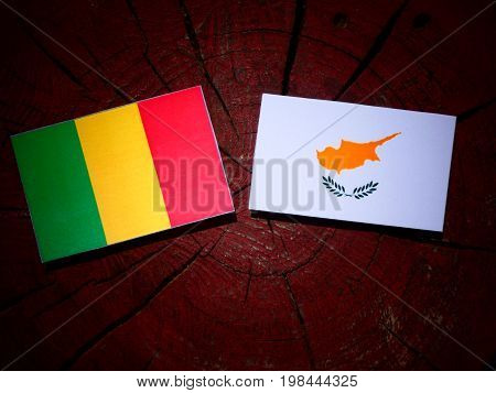 Malian Flag With Cypriot Flag On A Tree Stump Isolated