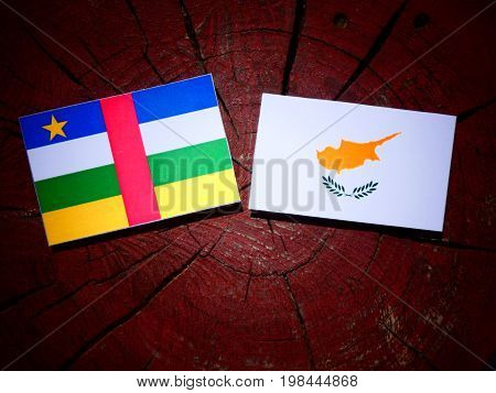 Central African Republic Flag With Cypriot Flag On A Tree Stump Isolated