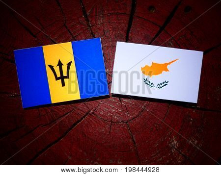 Barbados Flag With Cypriot Flag On A Tree Stump Isolated