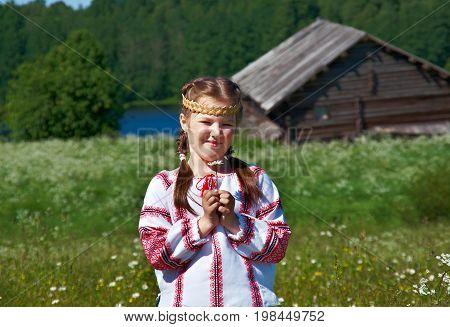 little Slavic girl in national dress in Russian village