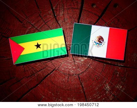 Sao Tome And Principe Flag With Mexican Flag On A Tree Stump Isolated