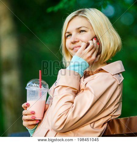 Girl With Milkshake And Phone