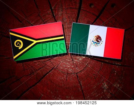 Vanuatu Flag With Mexican Flag On A Tree Stump Isolated