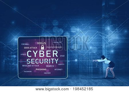 Picture of an Asian female entrepreneur pulling cyber security text on the board, concept of malware