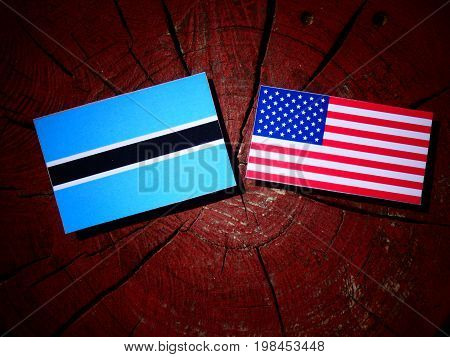 Botswana Flag With Usa Flag On A Tree Stump Isolated