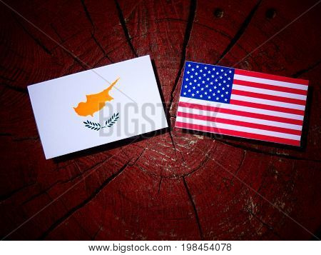 Cypriot Flag With Usa Flag On A Tree Stump Isolated