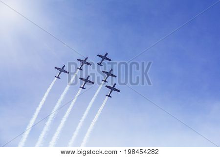 Image of jet planes showing beautiful maneuver in the blue sky