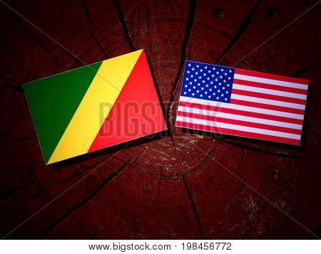 Republic Of The Congo Flag With Usa Flag On A Tree Stump Isolated
