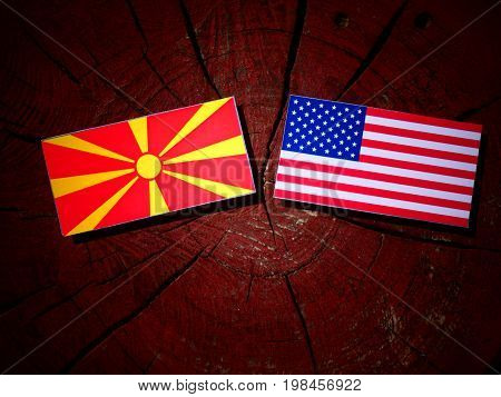 Macedonian Flag With Usa Flag On A Tree Stump Isolated