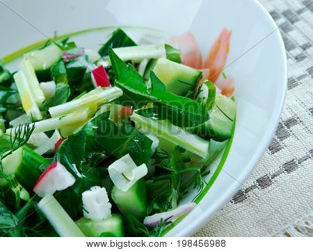 Traditional Slavic spring salad of dandelions freshness cooked close up