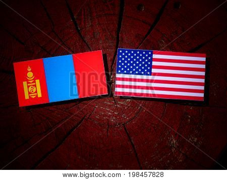Mongolian Flag With Usa Flag On A Tree Stump Isolated