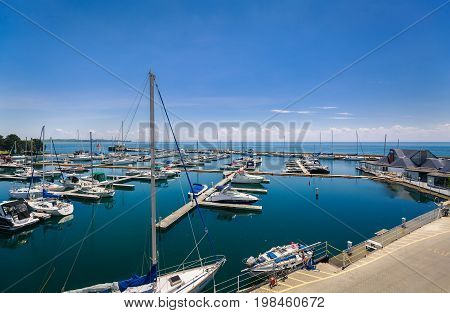 Toronto, Ontario, Canada, June 16, 2017, amazing view of various classic yachts and boats standing in lake Ontario place park bay on sunny summer day
