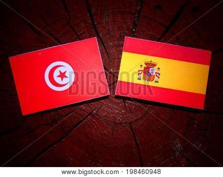 Tunisian Flag With Spanish Flag On A Tree Stump Isolated