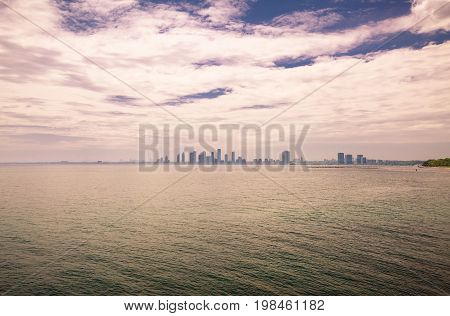 amazing gorgeous dramatic view on lake Ontario with beautiful mesmerizing sky and city background at sunset time