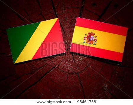 Republic Of The Congo Flag With Spanish Flag On A Tree Stump Isolated