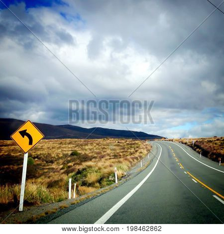 Sharp left bend in road for driving on Rangipo Desert Road New Zealand NZ