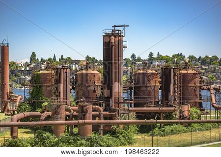 Abandoned Machines And Storage Units In A Gas Industry At Gas Works Park Seattle Homes Behind
