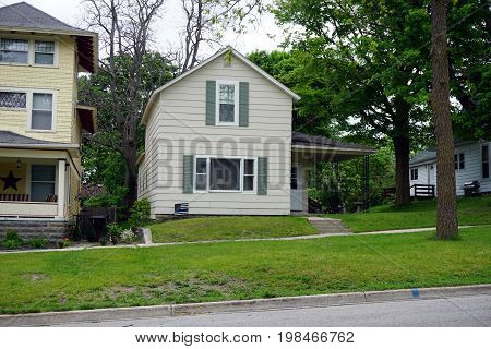 CADILLAC, MICHIGAN / UNITED STATES -  MAY 31, 2017: A two-story single family home in Cadillac's Courthouse Hill Historic District.