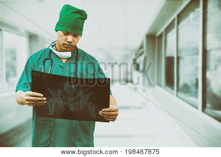 Surgical Doctor Looking At X-ray Film.