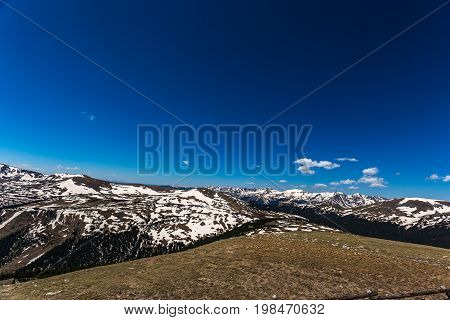 Trail Ridge Road is the name for a stretch of U.S. Highway 34 that traverses Rocky Mountain National Park from Estes Park Colorado in the east to Grand Lake Colorado in the west offering stunning mountain views.