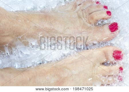 Woman's Feet In Soap Bubbles