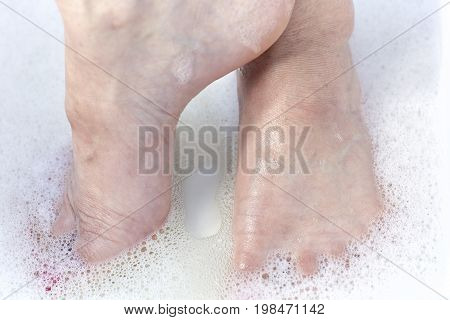 Woman's Feet Soaking In Water