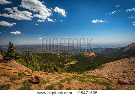 Pikes Peak is the highest summit of the southern Front Range of the Rocky Mountains. The ultra-prominent fourteener is located in Pike National Forest 12 miles west of downtown Colorado Springs. The mountain is named in honor of American explorer Zebulon