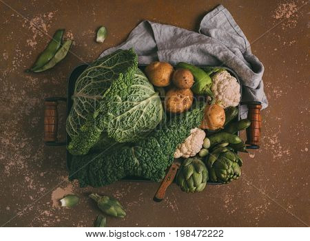 Different organic vegetables. Savoy cabbage cauliflower potatoes artichokes and broad beans