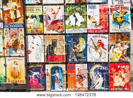 PARIS, FRANCE - JUNE 9, 2012: Colourful retro souvenir art cards for sale in Montmartre Paris.