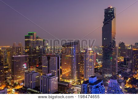 Aerial view of Bangkok modern office buildings condominium in Bangkok city downtown with sunset sky Bangkok Thailand