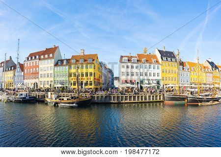 Copenhagen Denmark - May 1 2017: Nyhavn with its picturesque harbor with old sailing ships bobbing on the canals