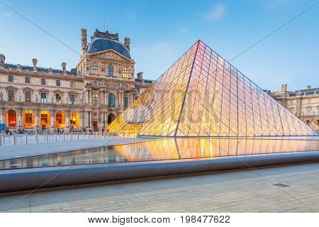Sunset View Of Louvre Museum In Paris, France