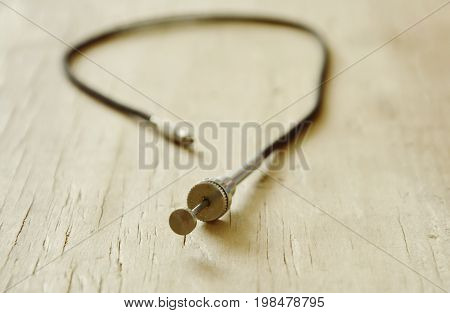 classic camera shutter cable released on wooden board