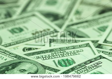 Hundred Dollar Bills In Green Light, Color Image, Selective Focus, Horizontal Image