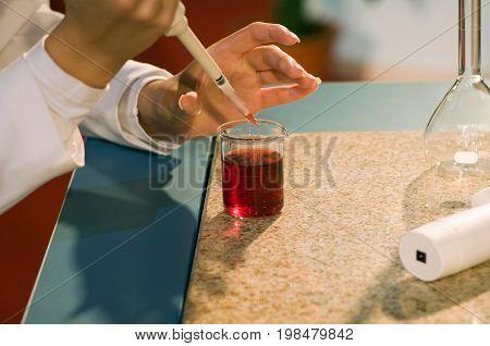 Laboratory technician at work color image selective focus horizontal image