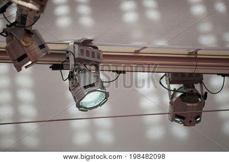 Stage Spotlights On Rail, Color Image, Selective Focus, Horizontal Image
