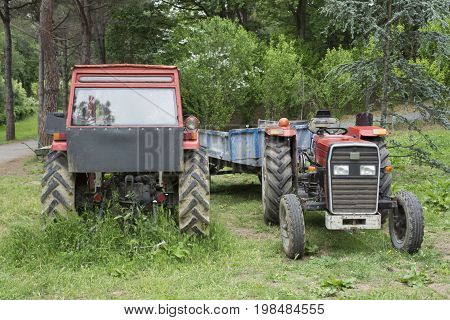 Two old tractors and trailers. Not used anymore