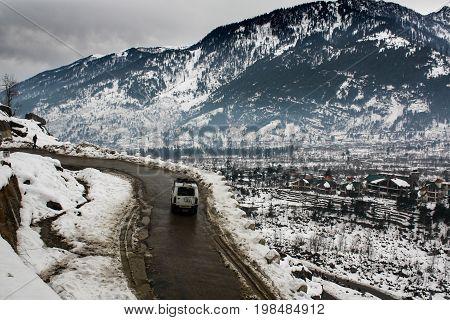 Landscape of snowy mountain road in winter