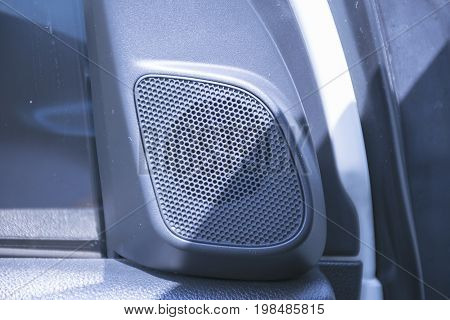 Close up Loundspeakers in a car. Sound system audio in transportation.