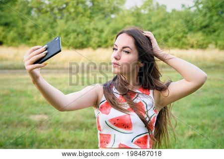 Young Beautiful Girl Doing Selfie At Sunset