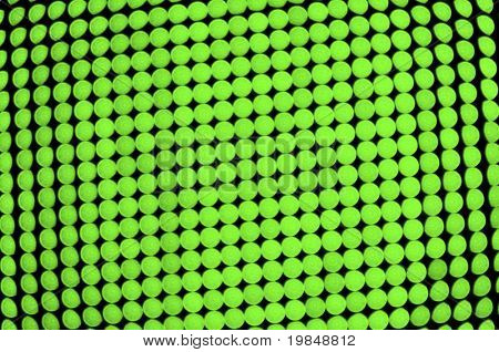 Abstract green background, out of focus green LEDs panel