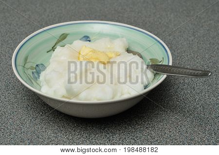 A traditional South African breakfast porridge made of maize with butter