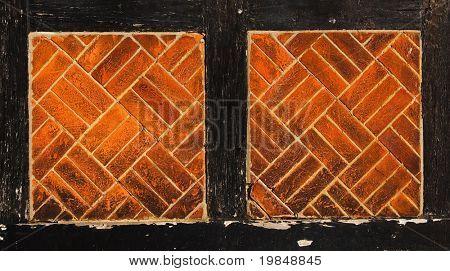 Brick and dark wood wall
