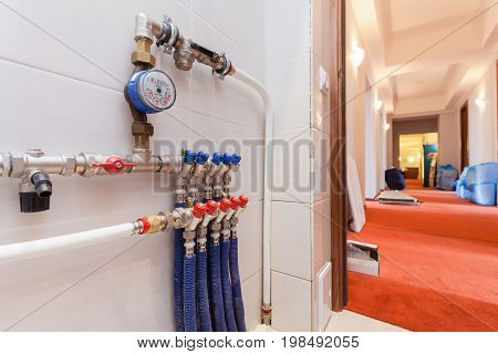 Copper valves stainless ball valves detector of water and plastic pipes of central heating system and water pipes in the boiler room equipment in apartment during under renovation remodeling and construction.