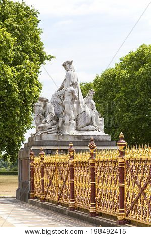 LONDON UNITED KINGDOM - JUNE 23 2017:Prince Albert Memorial Kensington Gardens sculpture at the base of the monument London United Kingdom. It was commissioned by Queen Victoria in memory of her husband opened in July 1872