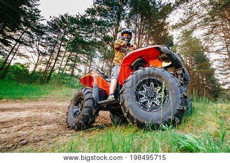 Man on the ATV Quad Bike running in mud track.