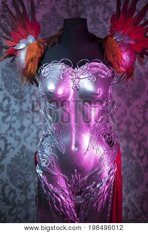 Retro, Fantasy, woman armor. Strong handmade metal breastplate in silver with gothic shapes and fine steel strands