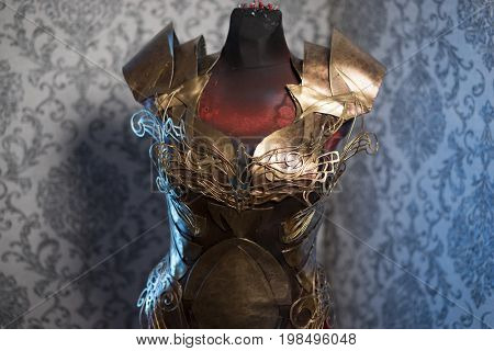 Knight Armor of woman Strong metal breastplate handmade in gold with gothic shapes and fine steel strands