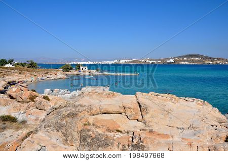 Kolimbithres beach and view on Naoussa town on Paros island in Greece