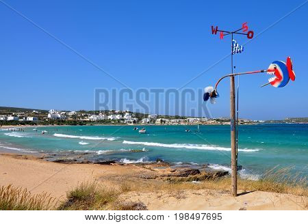 Santa Maria beach greek motive with bright red and blue windbreak decoration with sea water